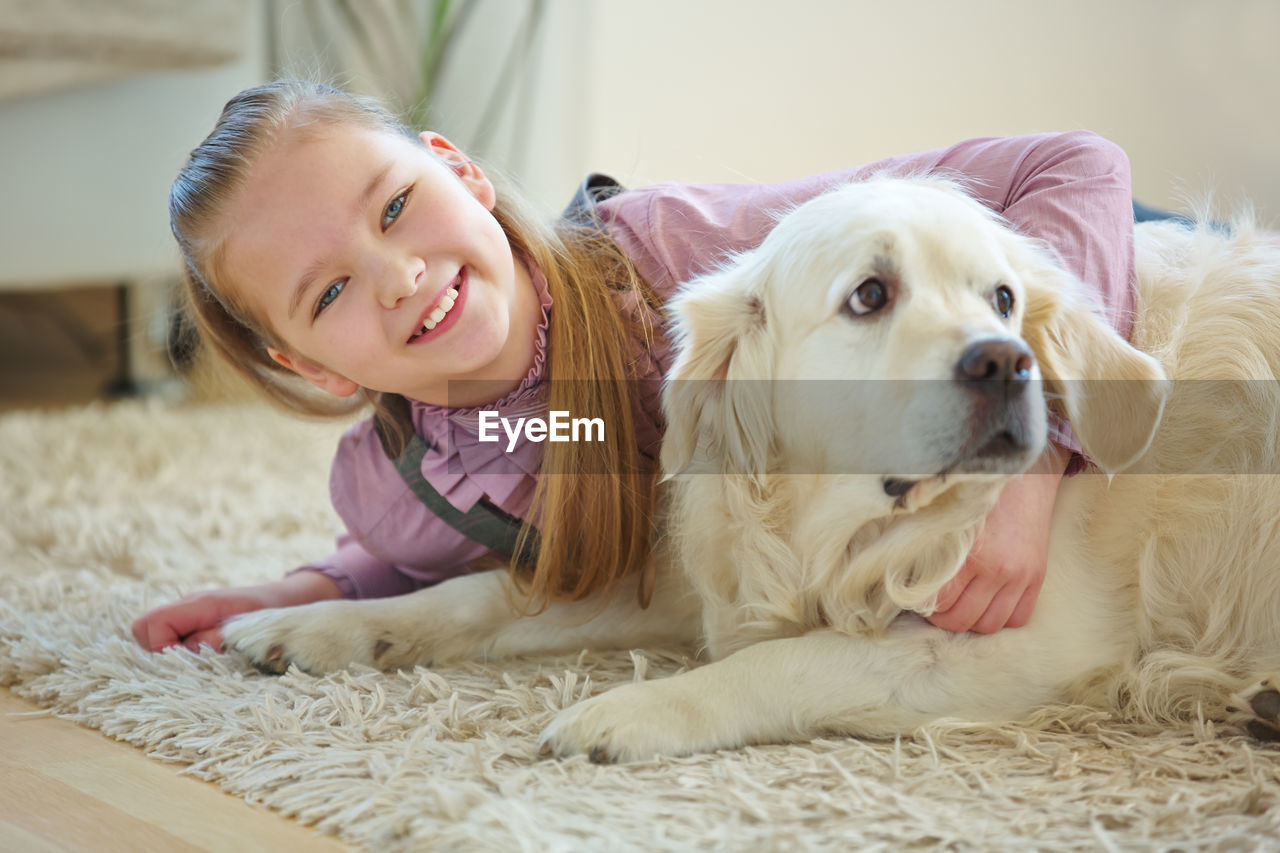 PORTRAIT OF CUTE GIRL WITH DOG ON WOMAN