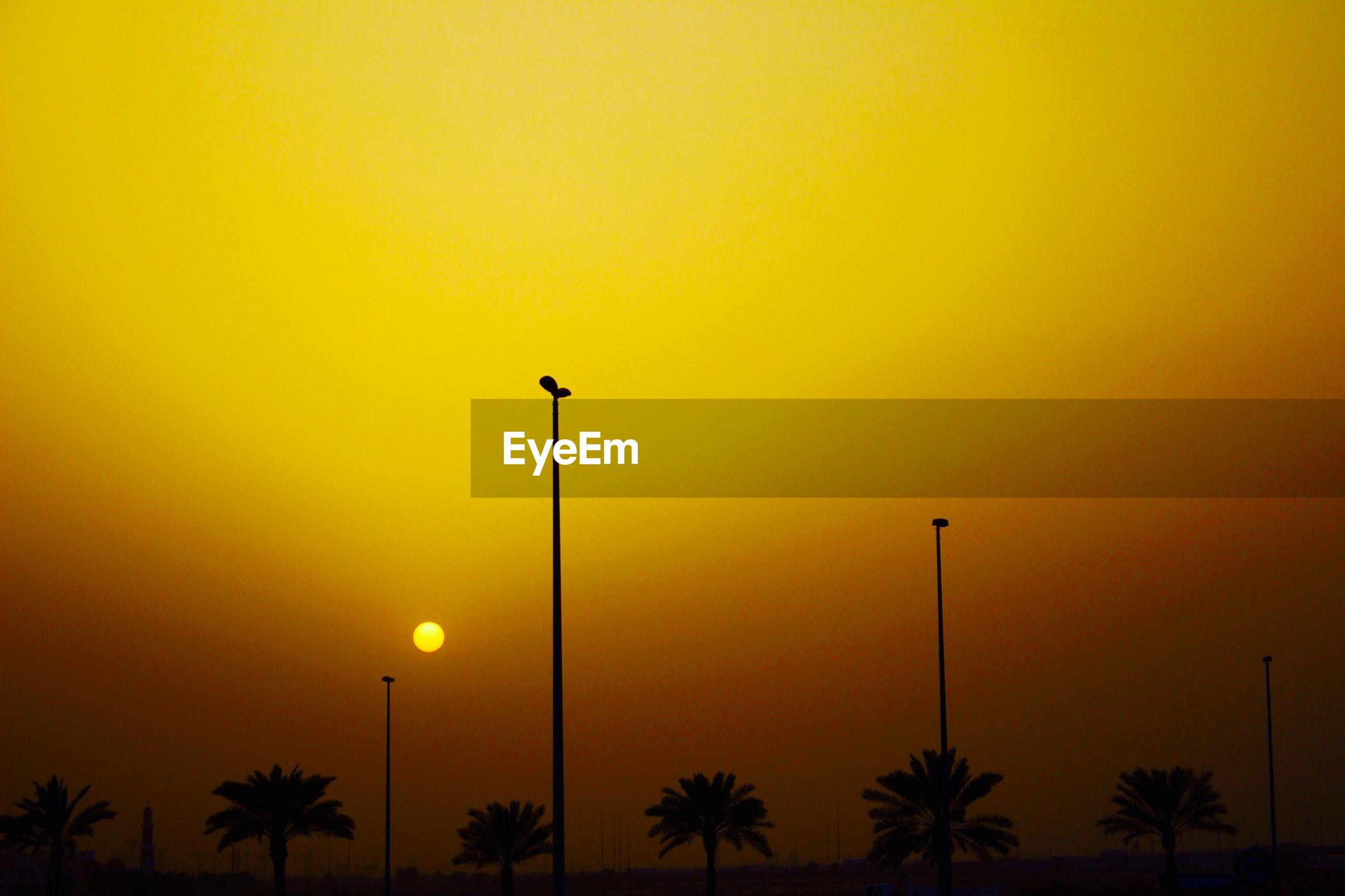 LOW ANGLE VIEW OF YELLOW ORANGE SKY