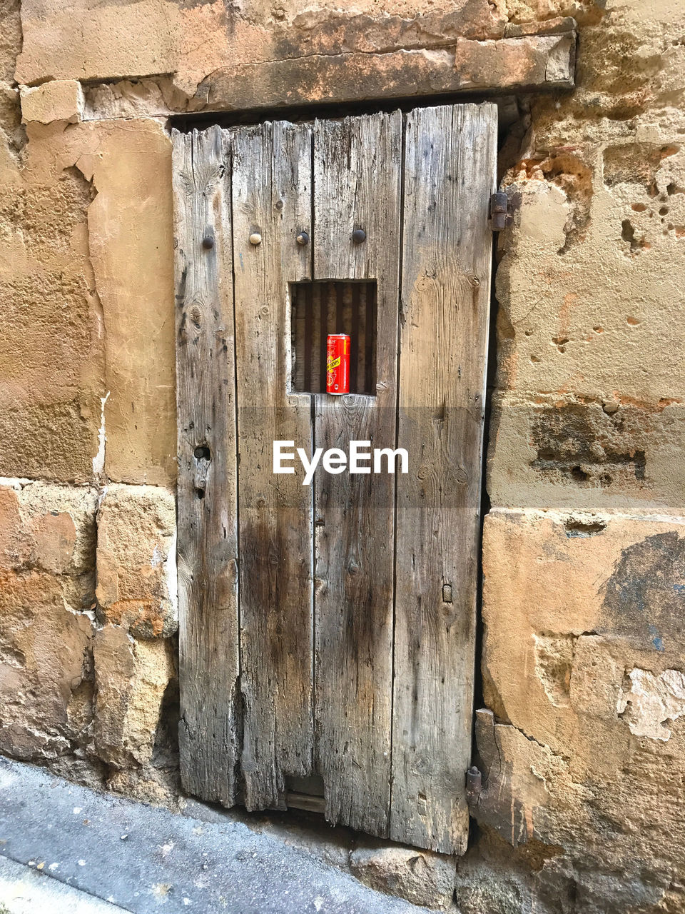 architecture, built structure, wall - building feature, wall, door, entrance, no people, building exterior, safety, day, security, protection, wood - material, stone wall, old, outdoors, building, closed, brick, house