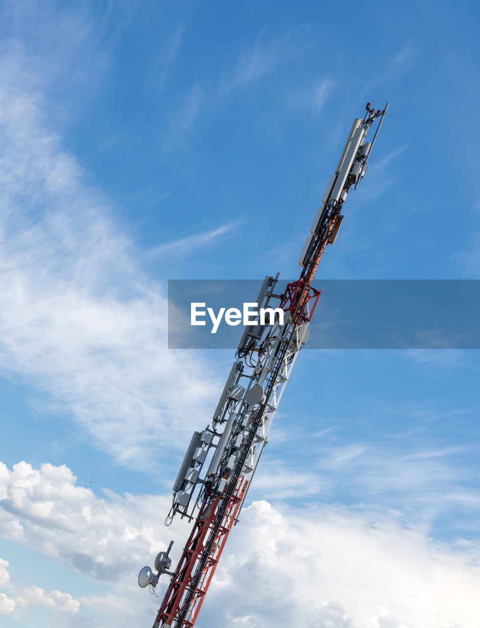 cloud - sky, sky, low angle view, crane - construction machinery, day, nature, machinery, no people, tall - high, industry, metal, outdoors, construction industry, blue, development, architecture, construction machinery, construction site, built structure, tower