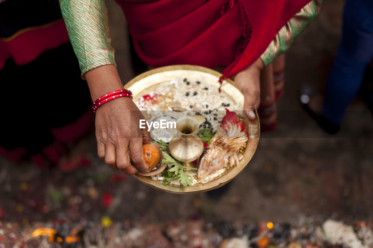 Close Up Of Woman Holding Tray