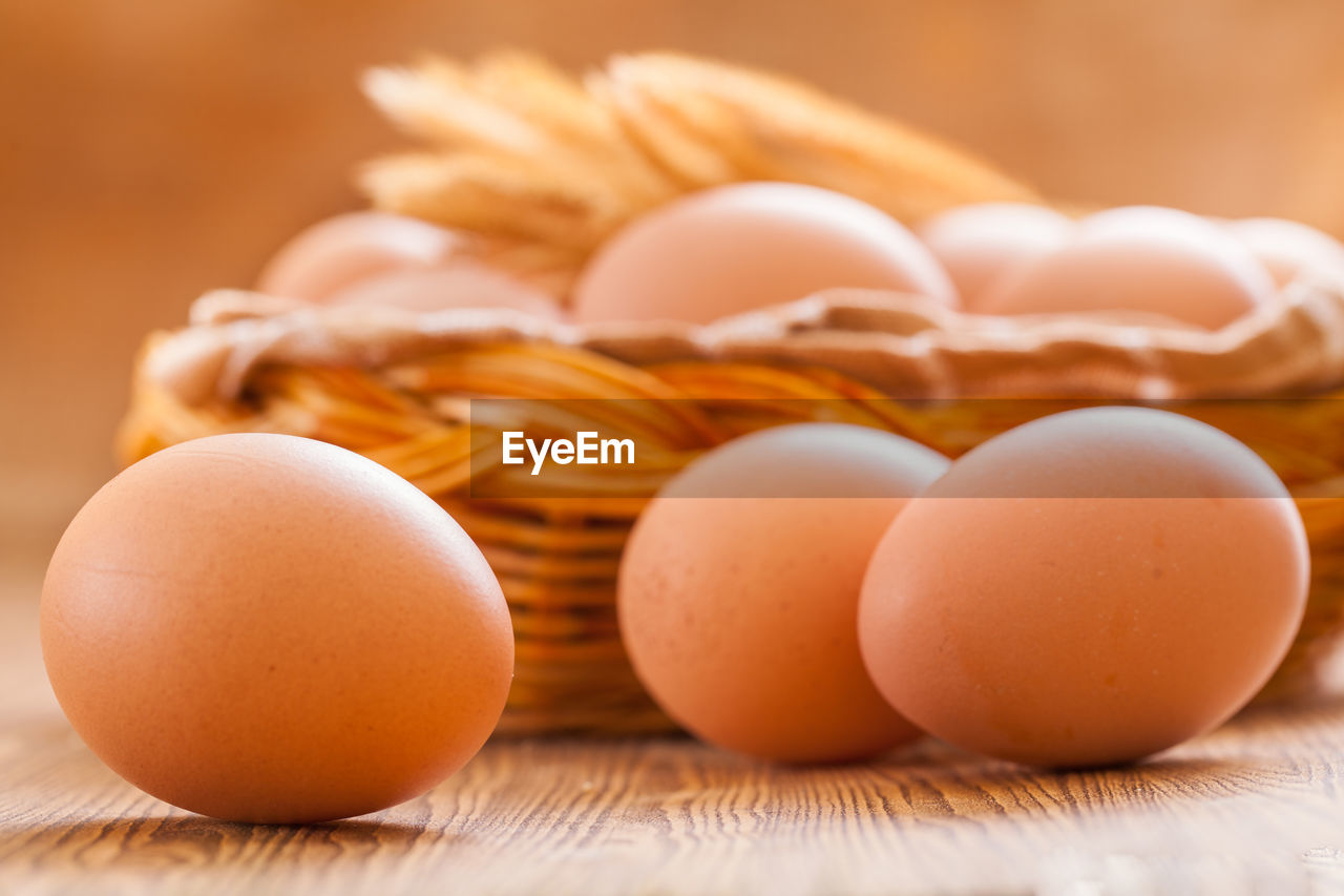 food, food and drink, freshness, healthy eating, wellbeing, still life, egg, table, close-up, indoors, brown, no people, wood - material, raw food, focus on foreground, selective focus, container, protein, group of objects, large group of objects