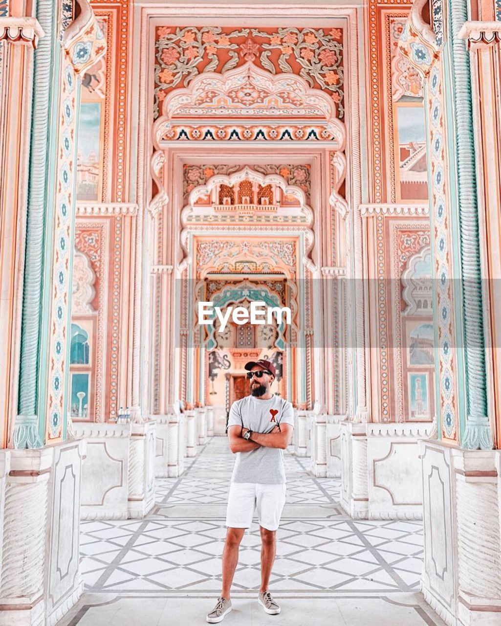 architecture, one person, full length, front view, real people, built structure, standing, building, young adult, day, travel destinations, religion, lifestyles, tourism, portrait, leisure activity, the past, looking at camera, place of worship, architectural column, ornate, luxury
