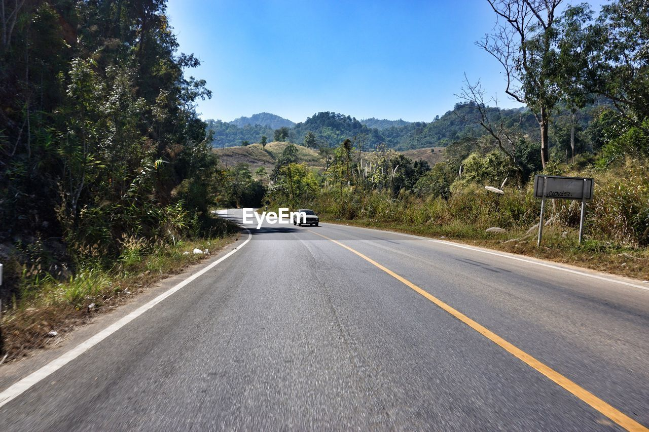 road, the way forward, transportation, day, mountain, tree, no people, outdoors, asphalt, nature, landscape, scenics, sky, clear sky, beauty in nature
