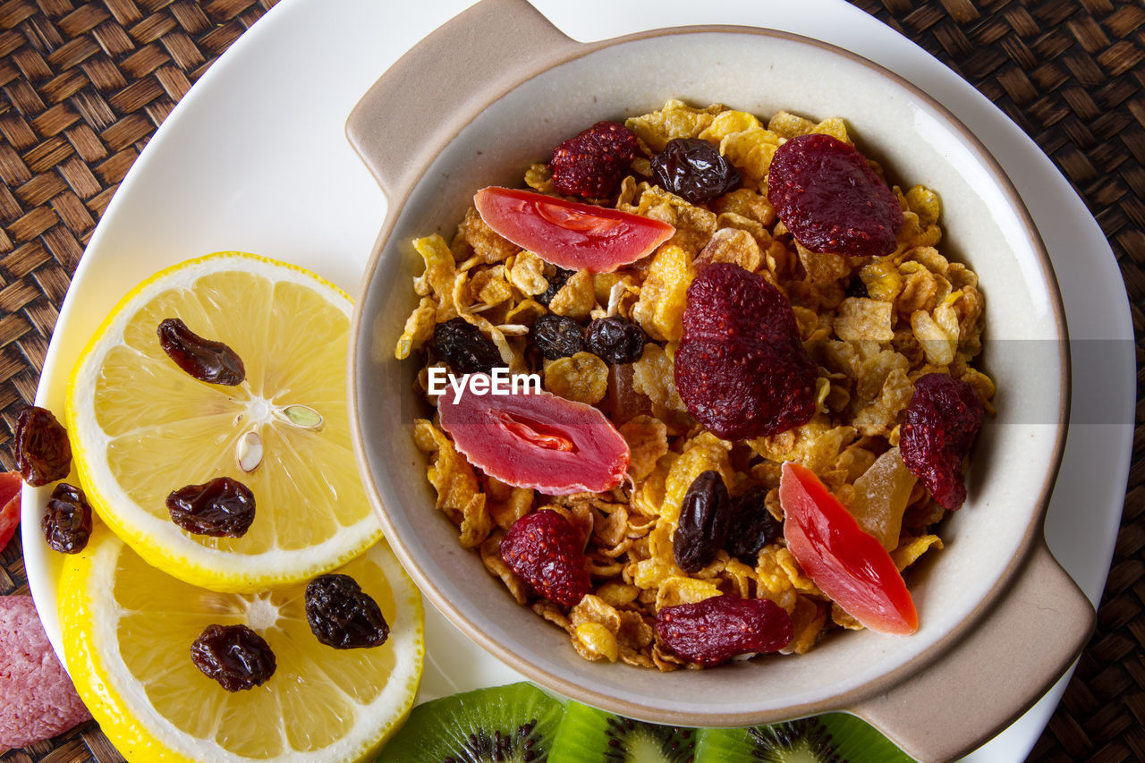 food and drink, food, fruit, healthy eating, wellbeing, freshness, breakfast, table, bowl, still life, ready-to-eat, berry fruit, no people, meal, indoors, high angle view, close-up, breakfast cereal, directly above, drink, orange