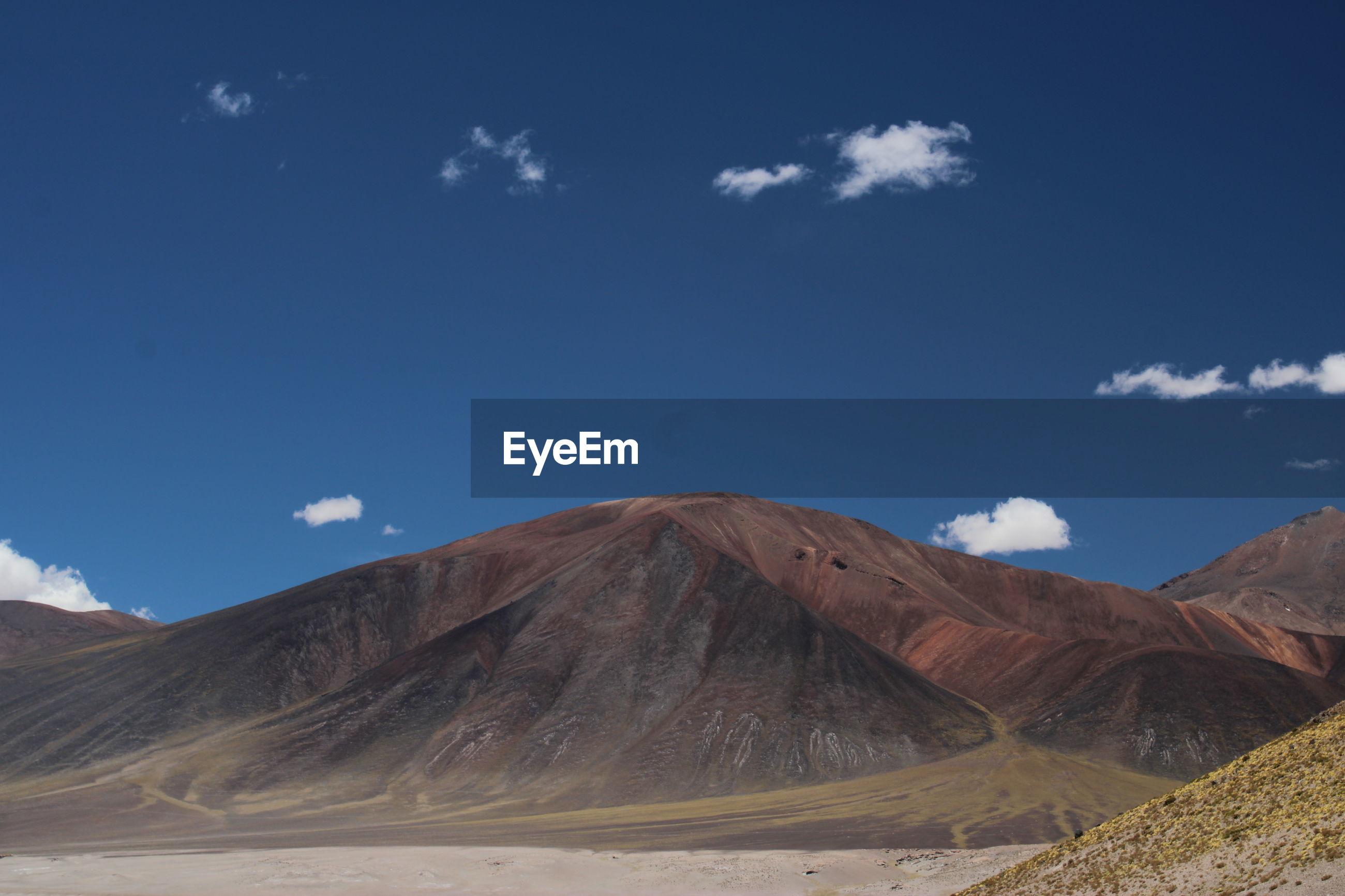 The blue sky and red mountains of piedras rojas, atacama desert, chile