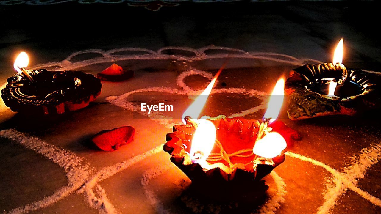 flame, burning, fire - natural phenomenon, heat - temperature, glowing, candle, illuminated, diya - oil lamp, celebration, night, diwali, oil lamp, tradition, indoors, traditional festival, no people, close-up