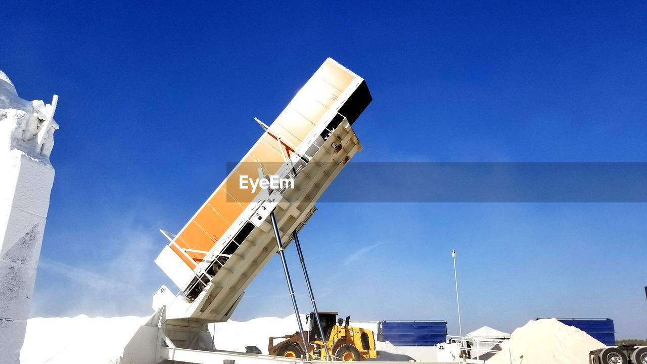 blue, day, outdoors, low angle view, sky, sunlight, built structure, architecture, no people, clear sky, nature, nautical vessel, building exterior