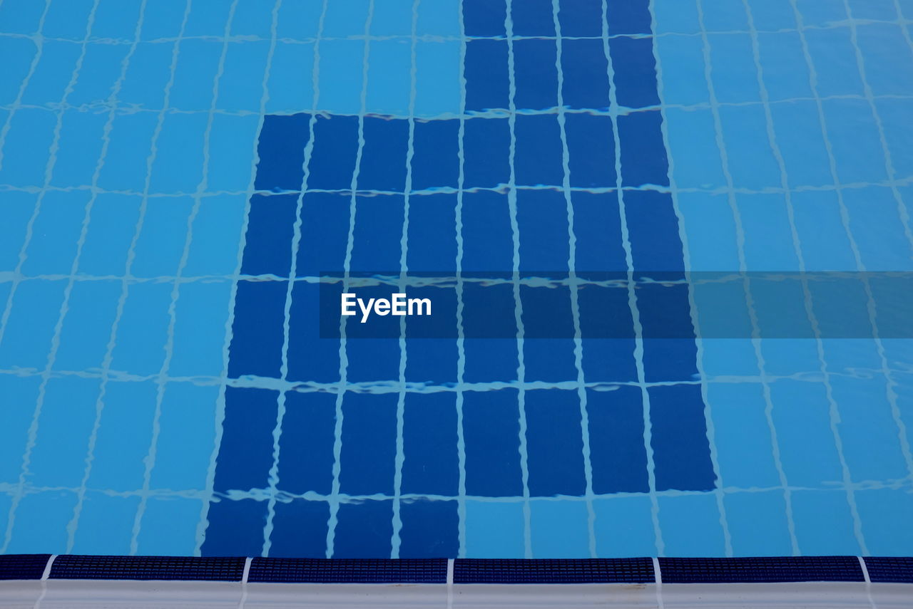 blue, swimming pool, day, no people, pool, full frame, nature, pattern, reflection, architecture, tile, low angle view, outdoors, backgrounds, sky, flooring, water, solar energy, sunlight, built structure, turquoise colored