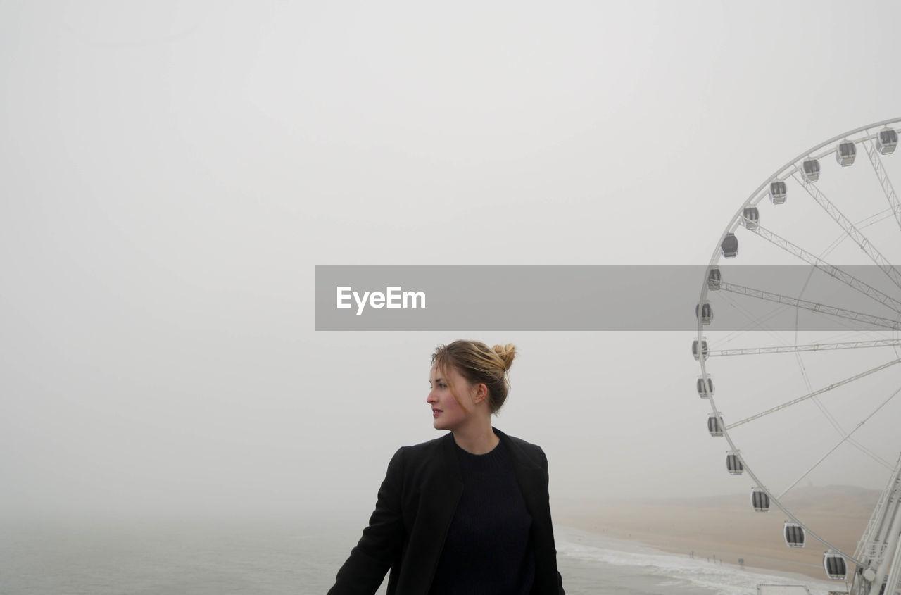 Woman By Beach In Fog