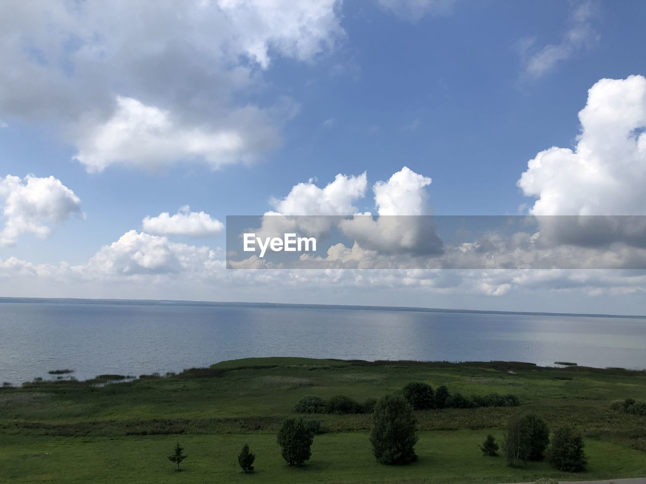 sky, cloud - sky, water, scenics - nature, sea, beauty in nature, tranquility, tranquil scene, plant, land, day, horizon, grass, nature, non-urban scene, horizon over water, green color, landscape, environment, no people, outdoors