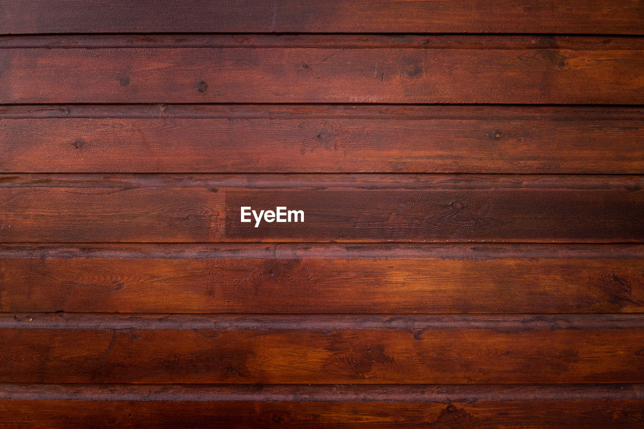 wood - material, backgrounds, pattern, textured, wood, brown, plank, striped, in a row, full frame, knotted wood, wood grain, hardwood, flooring, timber, no people, close-up, material, indoors, rough, wood paneling, abstract, surface level, uneven, dark, textured effect