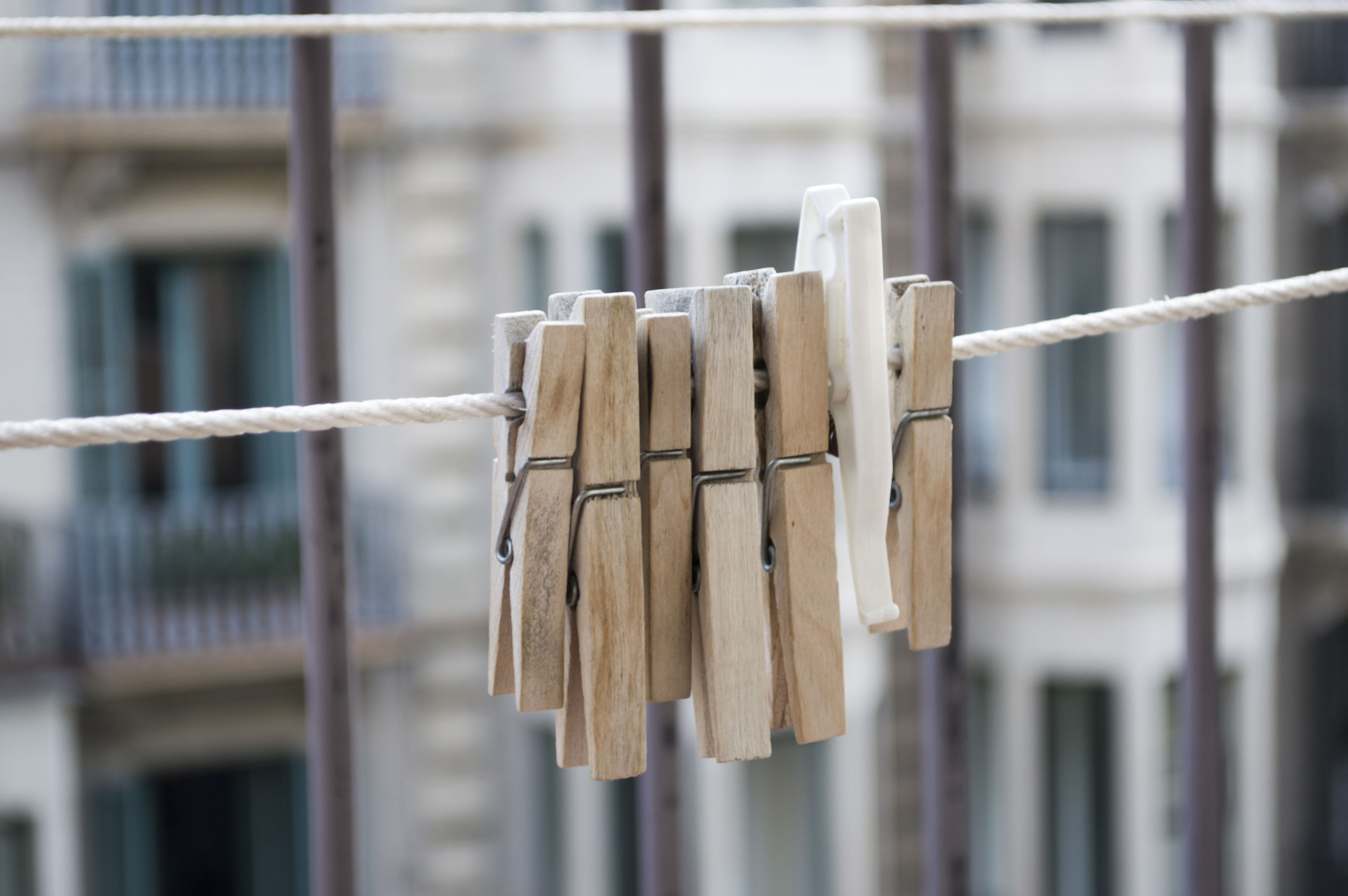Close-up of clothespin hanging on clothesline