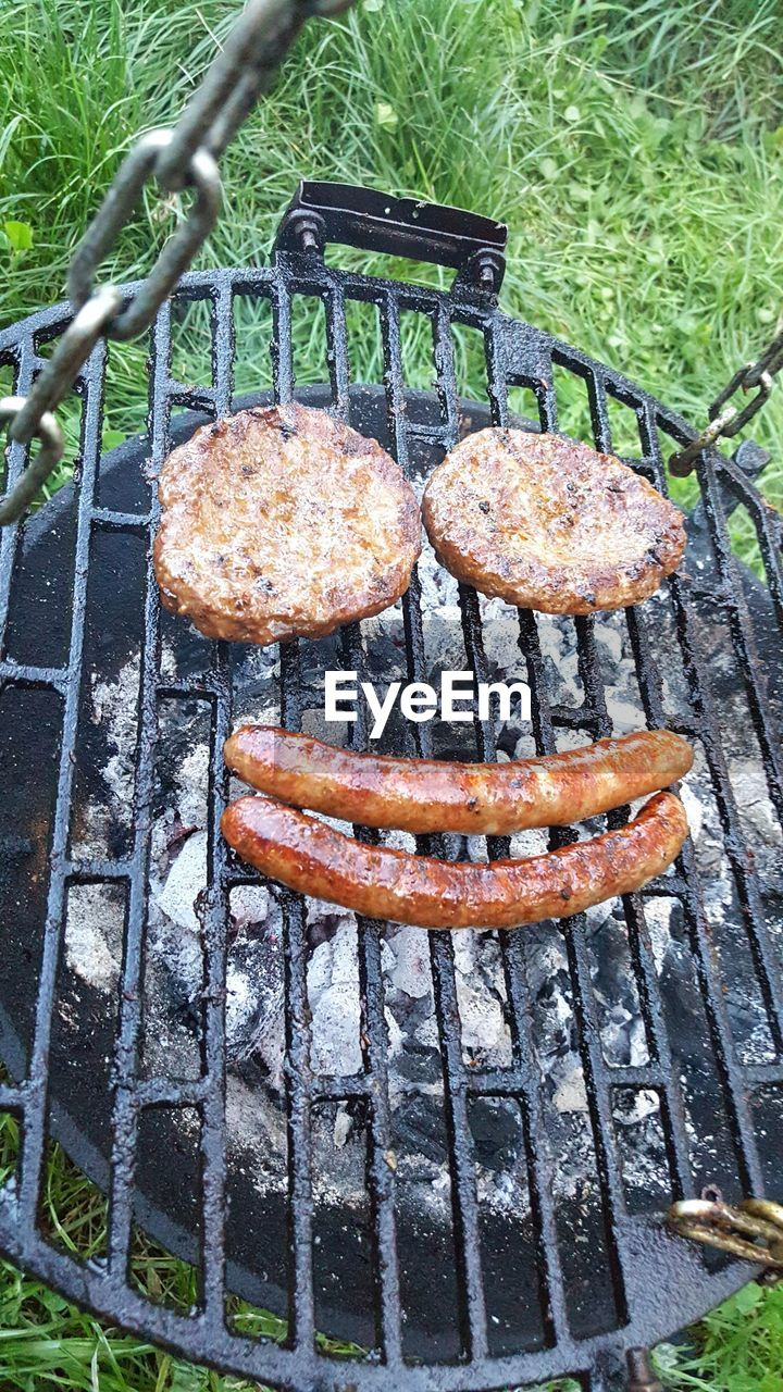 barbecue, barbecue grill, grilled, food and drink, metal, no people, preparation, meat, food, day, outdoors, metal grate, unhealthy eating, freshness, sausage, close-up, ready-to-eat