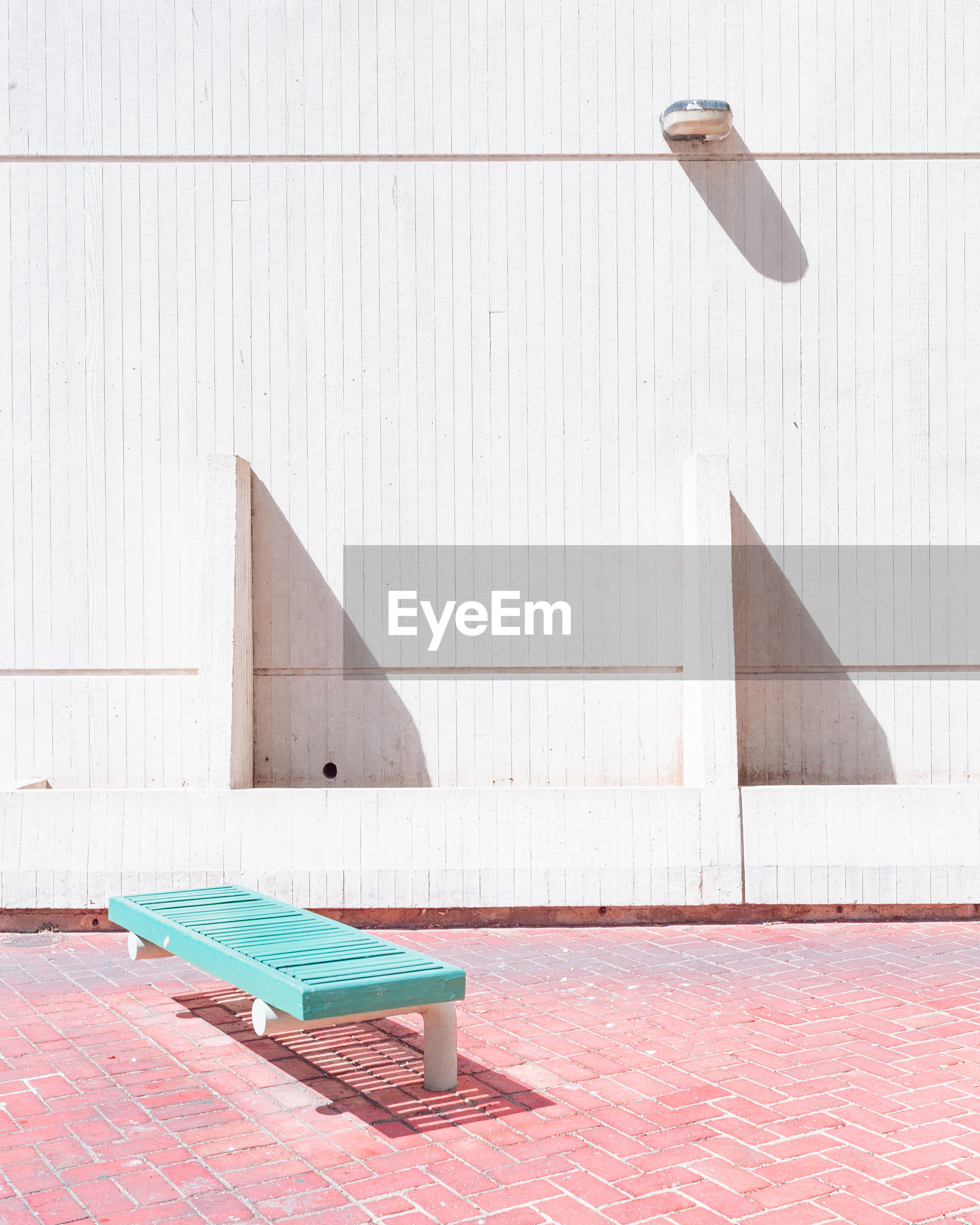 Bench against building