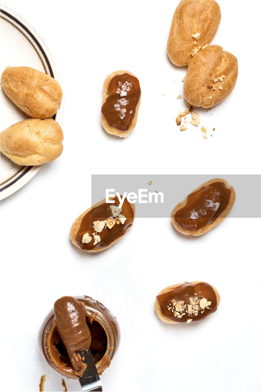 food and drink, food, white background, still life, indoors, studio shot, high angle view, freshness, brown, no people, close-up, baked, sweet food, indulgence, nut, snack, directly above, nut - food, unhealthy eating, group of objects, temptation