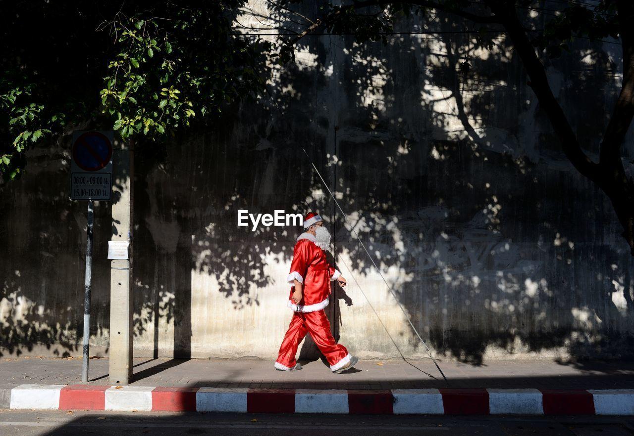 Santa Claus Walking On Footpath