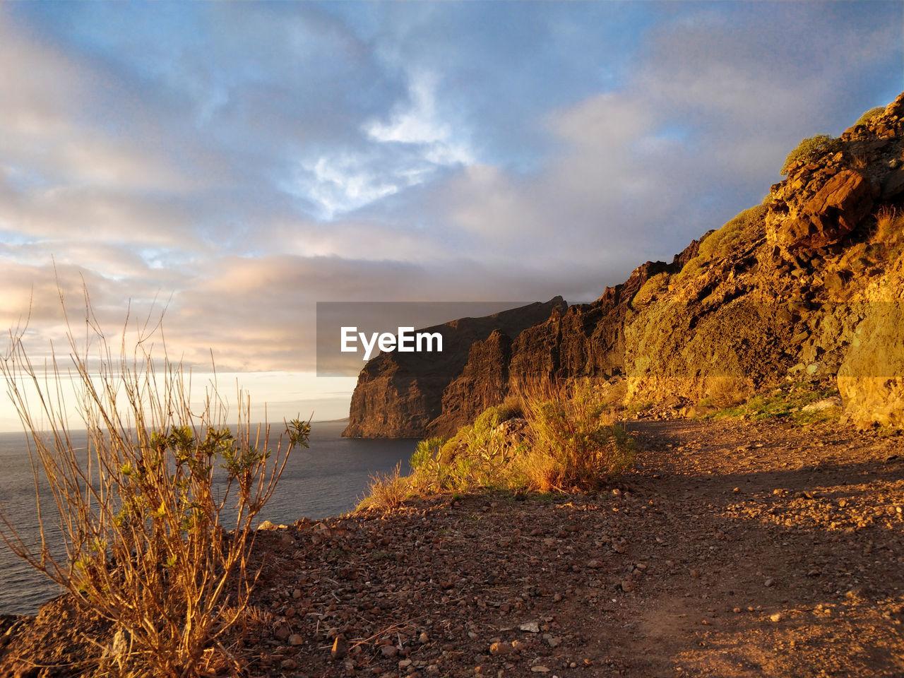 sky, water, cloud - sky, scenics - nature, beauty in nature, tranquility, tranquil scene, sea, nature, beach, no people, sunset, non-urban scene, land, mountain, rock, idyllic, plant, outdoors
