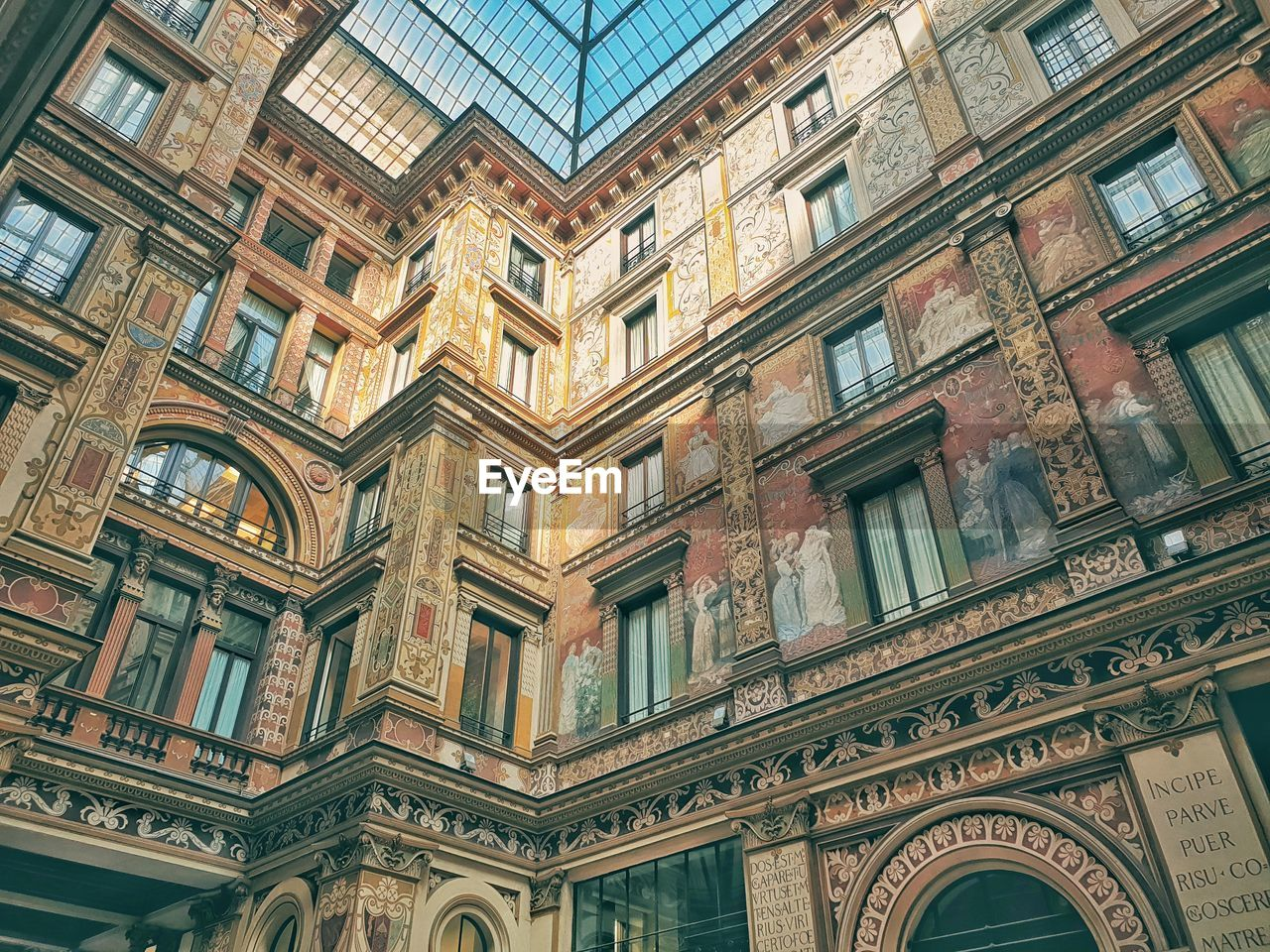 built structure, architecture, building exterior, low angle view, building, window, no people, full frame, day, glass - material, backgrounds, pattern, the past, history, residential district, city, arch, outdoors, in a row, repetition, ceiling, ornate, apartment