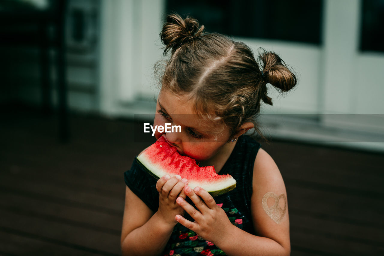 Close-Up Of Girl Eating Watermelon