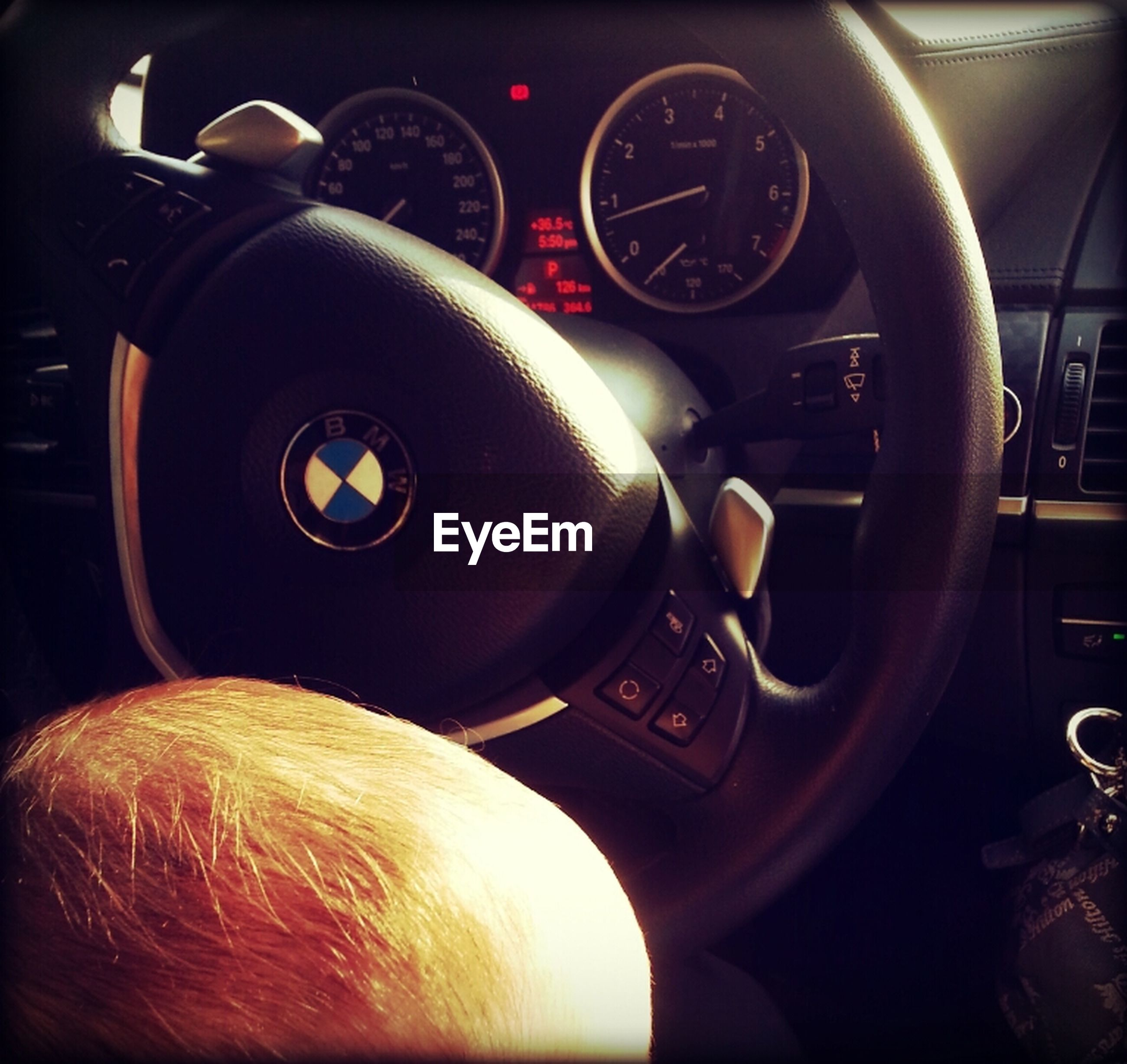 transportation, land vehicle, mode of transport, car, car interior, part of, vehicle interior, close-up, travel, cropped, side-view mirror, steering wheel, dashboard, reflection, vehicle part, technology, motorcycle, speedometer, stationary, photography themes