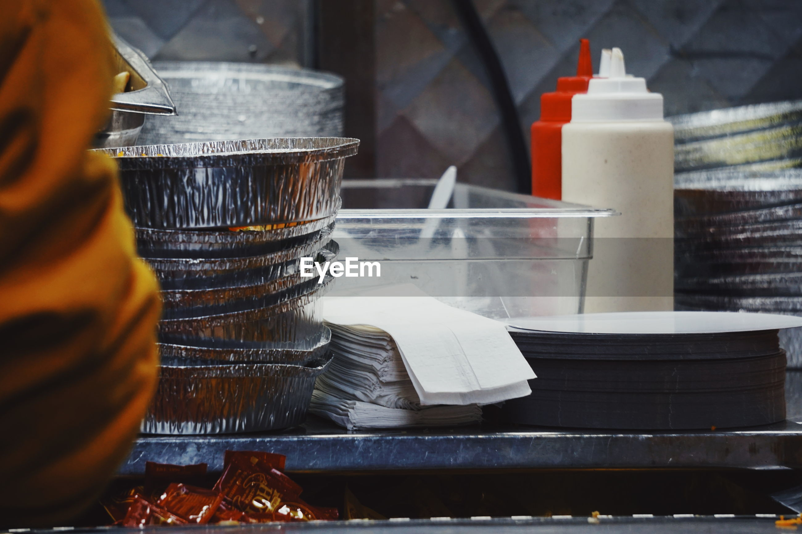 Close-up of containers at commercial kitchen
