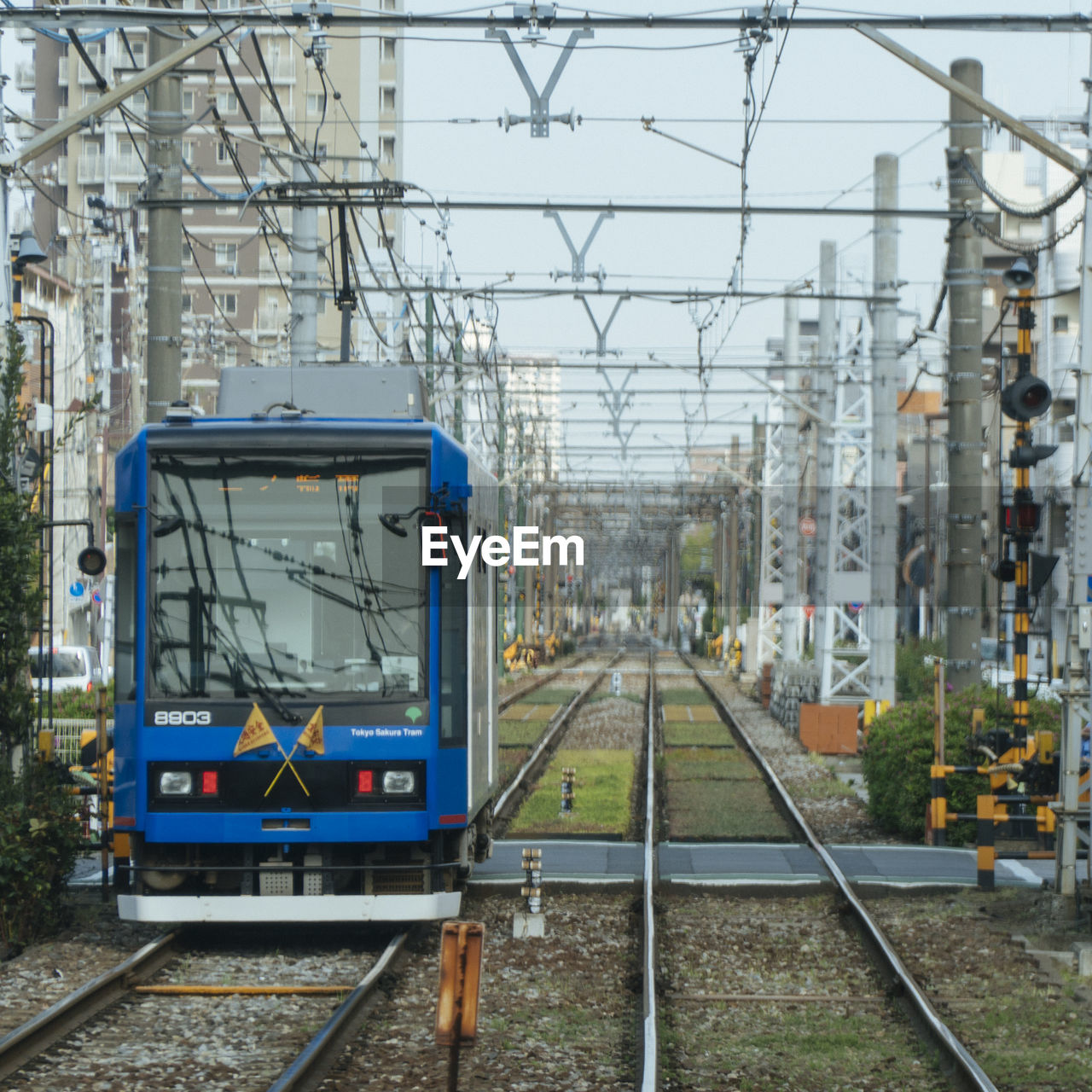 track, railroad track, rail transportation, transportation, mode of transportation, public transportation, electricity, architecture, day, nature, cable, train, train - vehicle, railroad station, railroad station platform, no people, built structure, outdoors, technology, connection, power supply, station