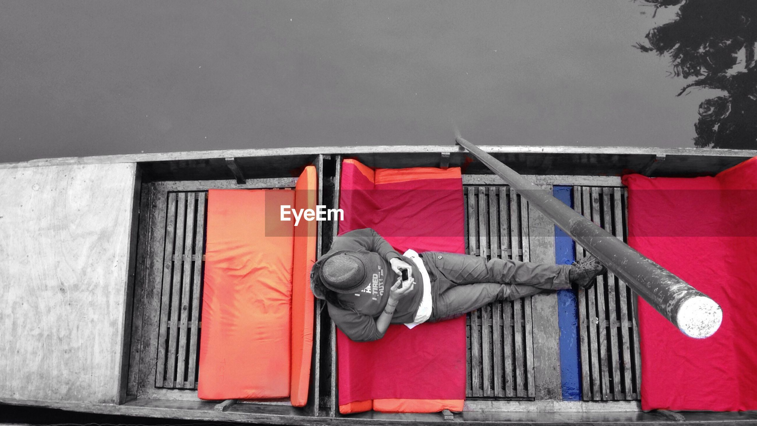 Directly above shot of man using mobile phone on boat