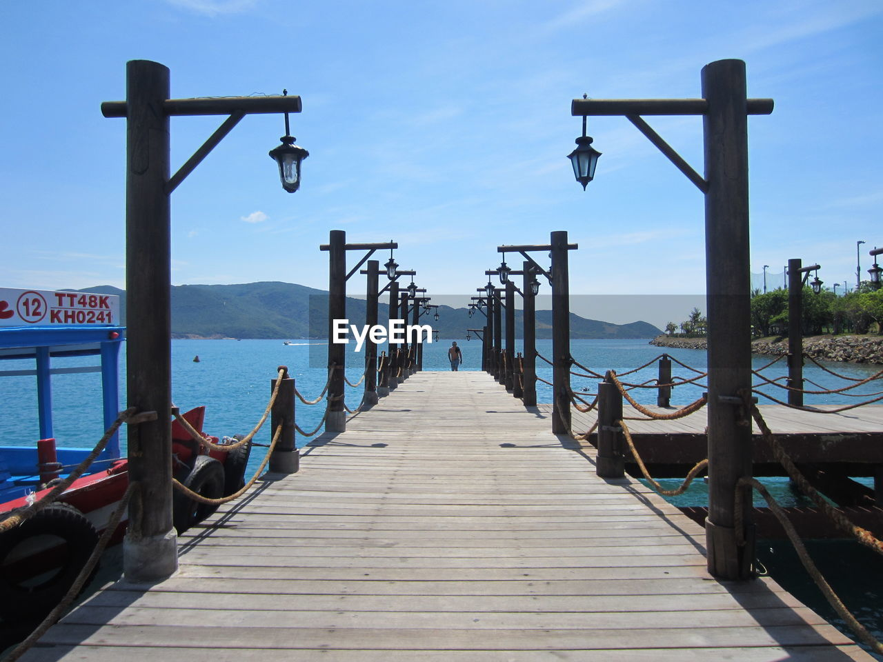 the way forward, direction, water, sky, wood - material, nature, diminishing perspective, sea, pier, architecture, built structure, day, railing, transportation, tranquility, outdoors, scenics - nature, no people, beauty in nature, wood, wooden post