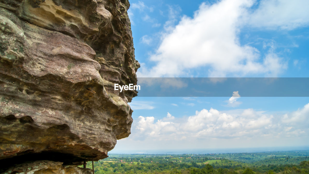 sky, cloud - sky, nature, day, beauty in nature, outdoors, scenics, rock - object, no people, tranquility, cliff, tree, tranquil scene, low angle view, mountain, close-up