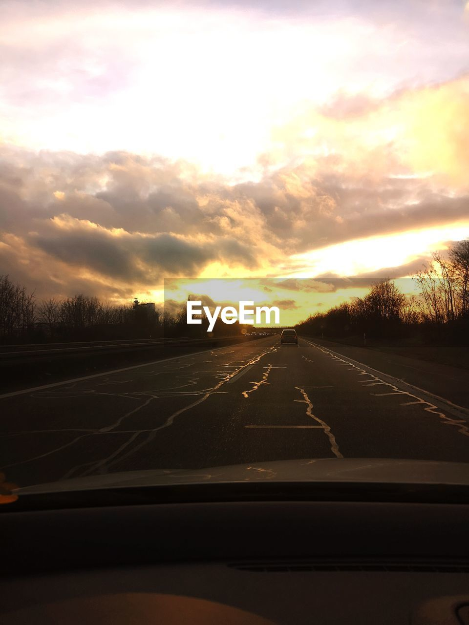 transportation, car, road, mode of transportation, vehicle interior, motor vehicle, sky, sunset, cloud - sky, land vehicle, transparent, car interior, windshield, no people, glass - material, nature, travel, car point of view, scenics - nature, direction, diminishing perspective, outdoors
