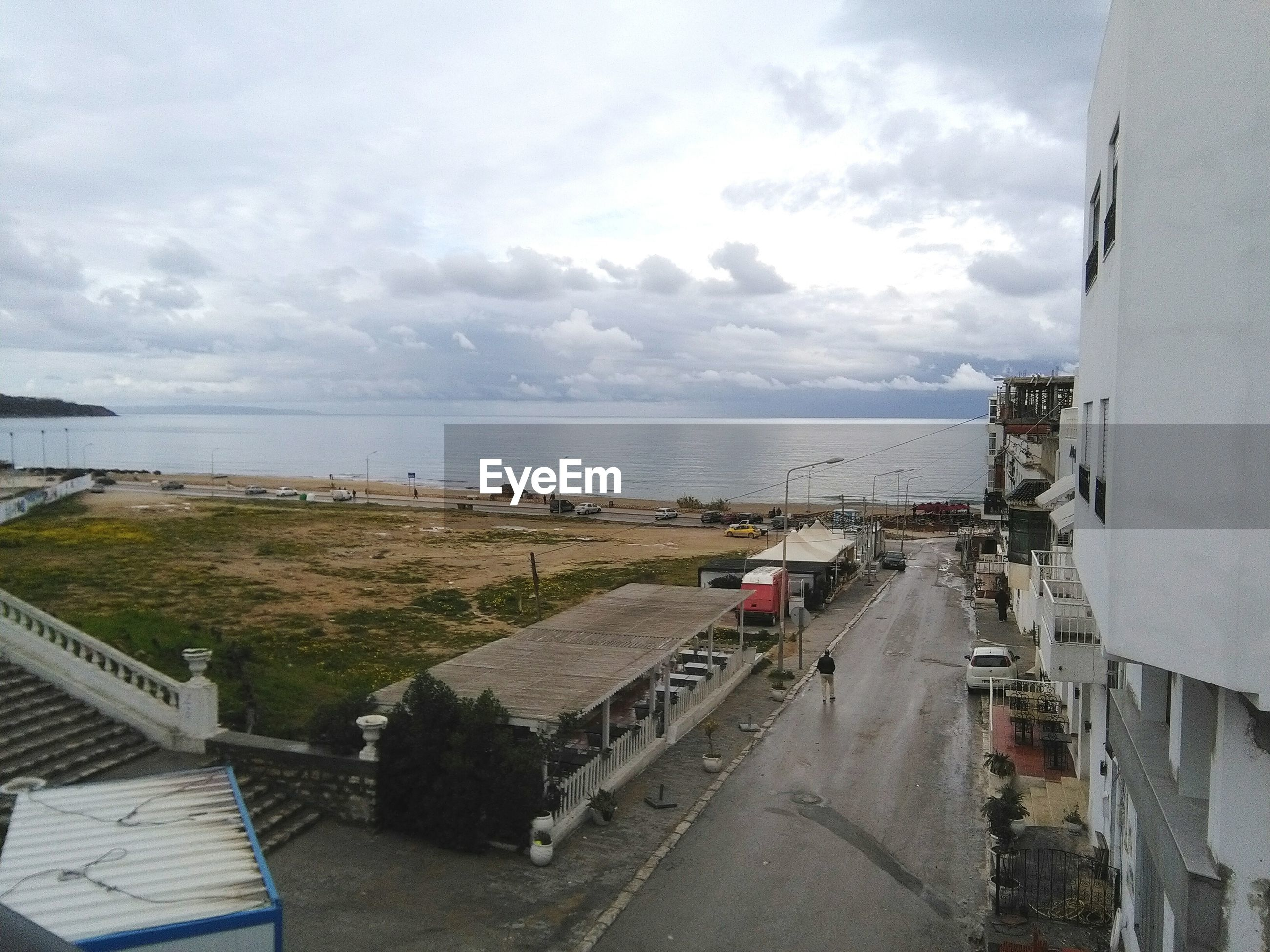 High angle view of road against calm sea
