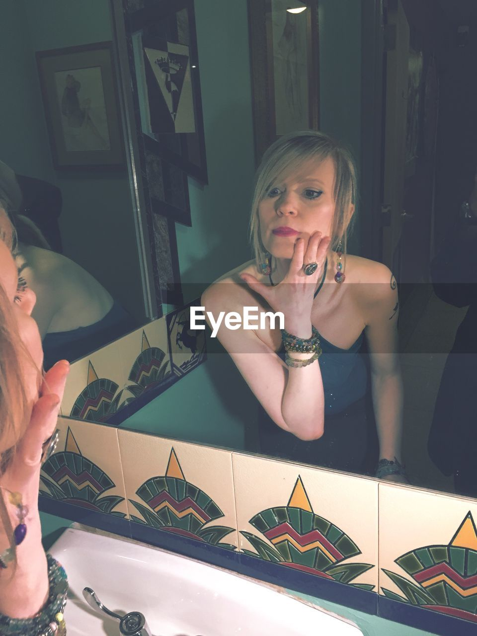 Mature Woman Looking At Her Reflection In Mirror