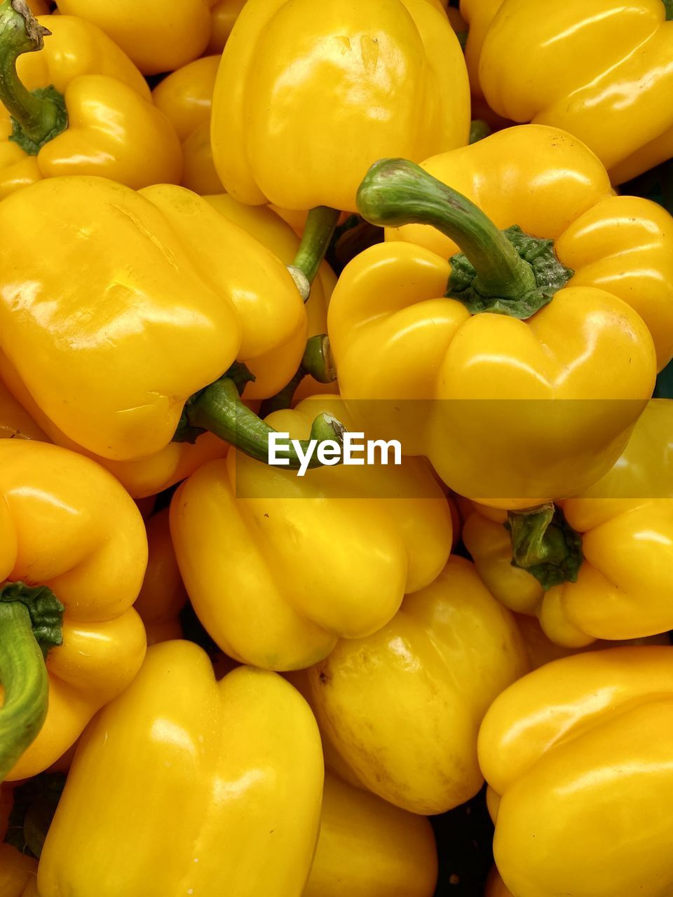 Close-up of yellow bell peppers for sale in market