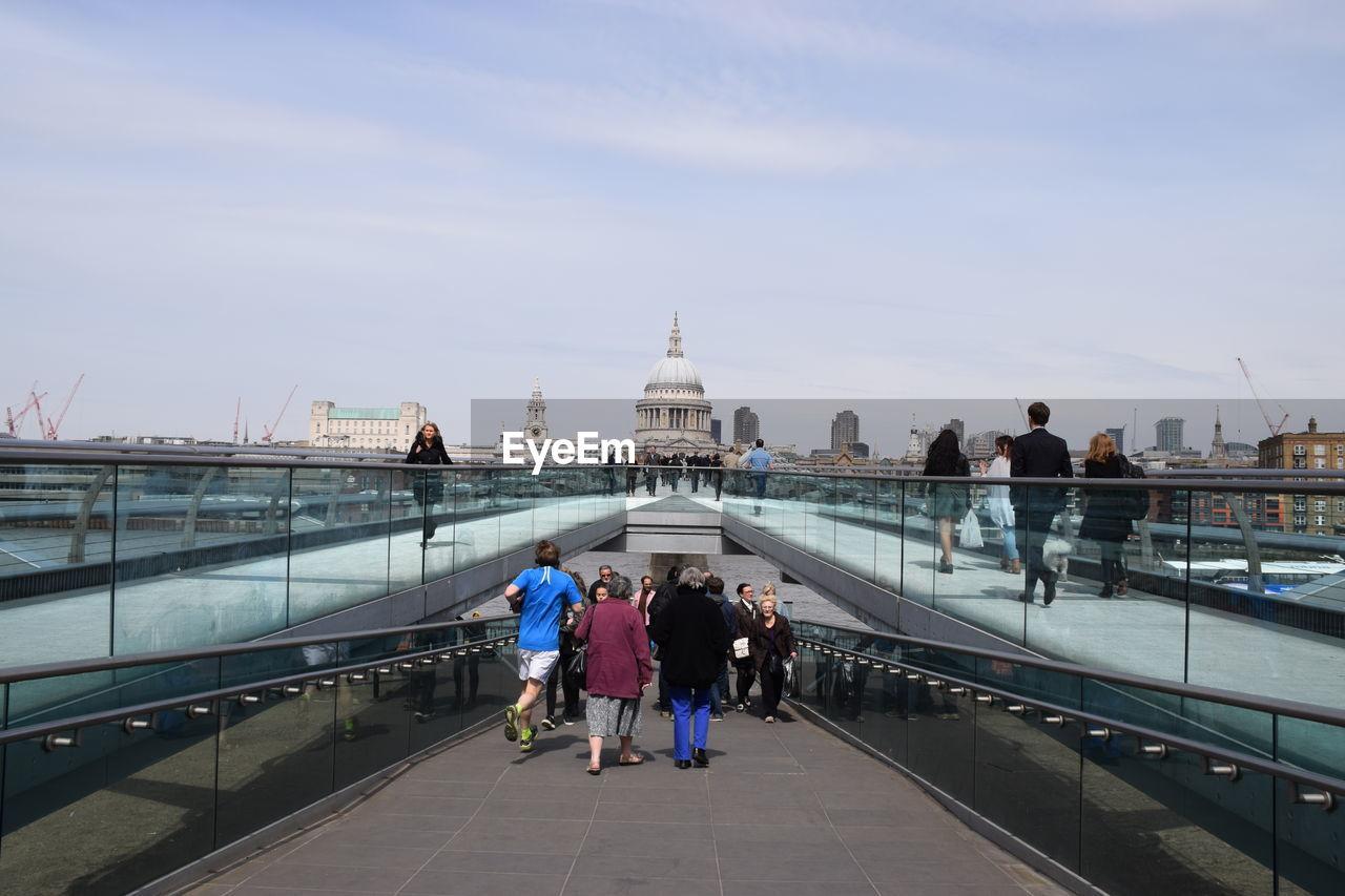 People On London Millennium Footbridge Leading Towards St Pauls Cathedral