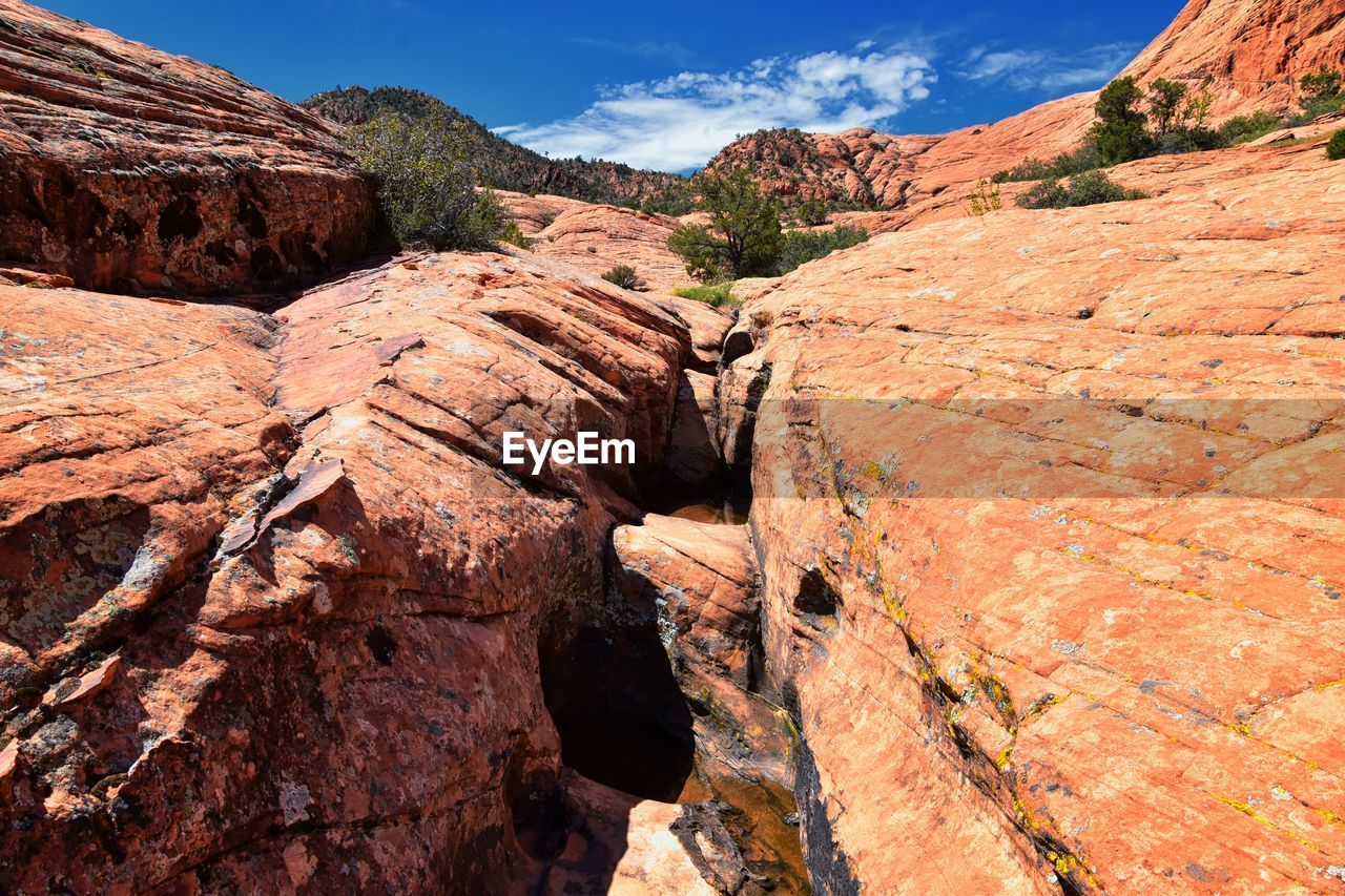 rock, rock - object, solid, rock formation, sky, scenics - nature, mountain, tranquility, beauty in nature, non-urban scene, tranquil scene, nature, geology, physical geography, no people, remote, day, sunlight, environment, mountain range, formation, outdoors, arid climate, eroded, climate, sandstone
