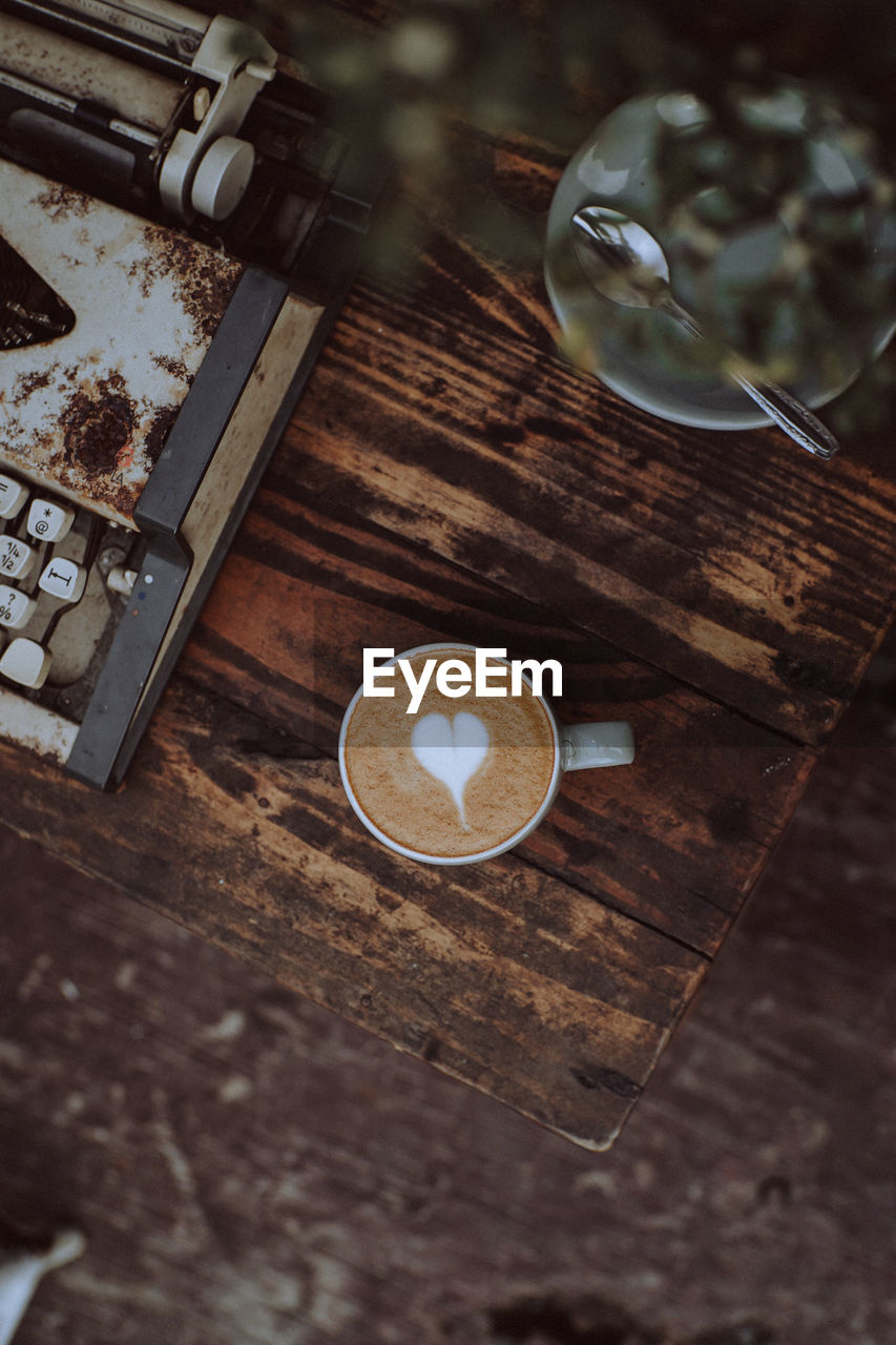 HIGH ANGLE VIEW OF COFFEE ON TABLE IN CAFE