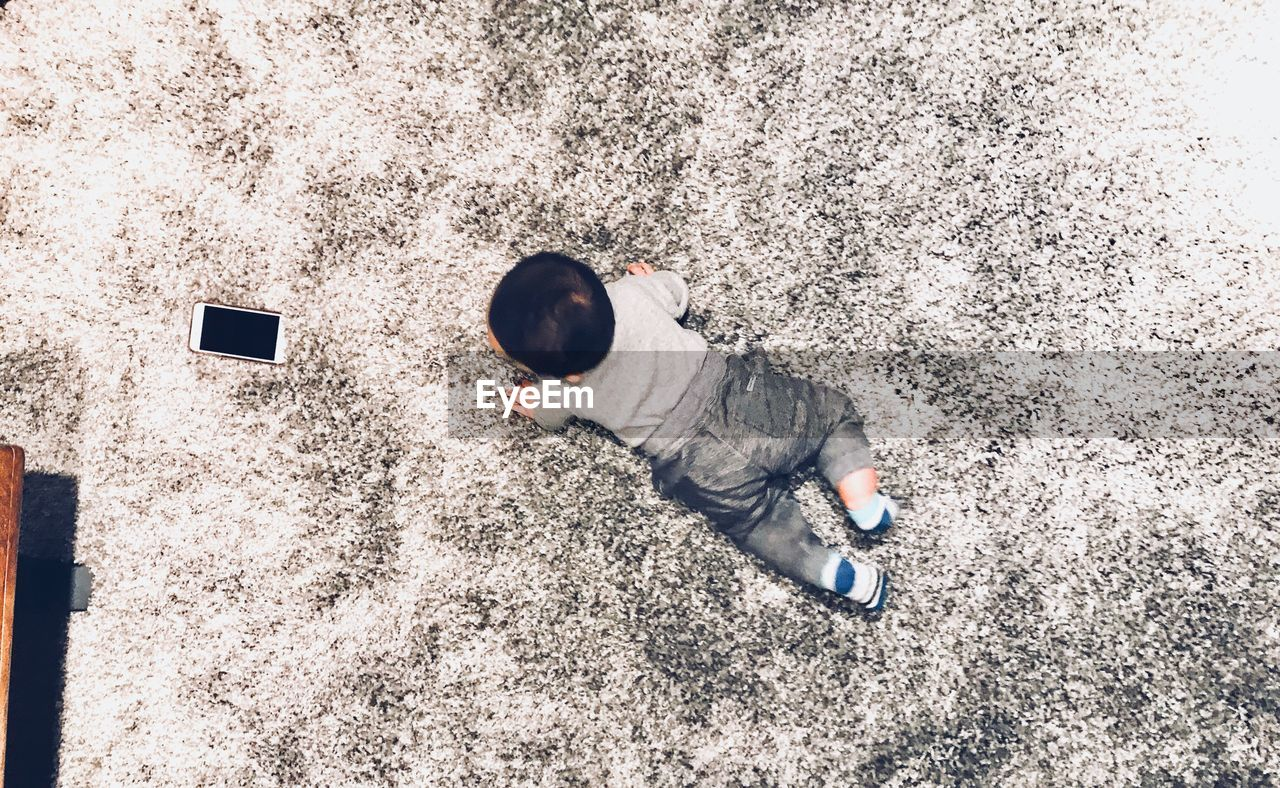 High angle view of baby boy on carpet