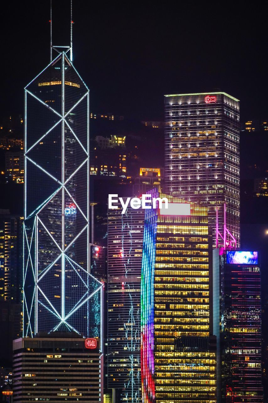 illuminated, night, architecture, city, built structure, building exterior, building, office building exterior, skyscraper, modern, tall - high, no people, cityscape, sky, glowing, lighting equipment, travel destinations, nature, downtown district, city life, financial district