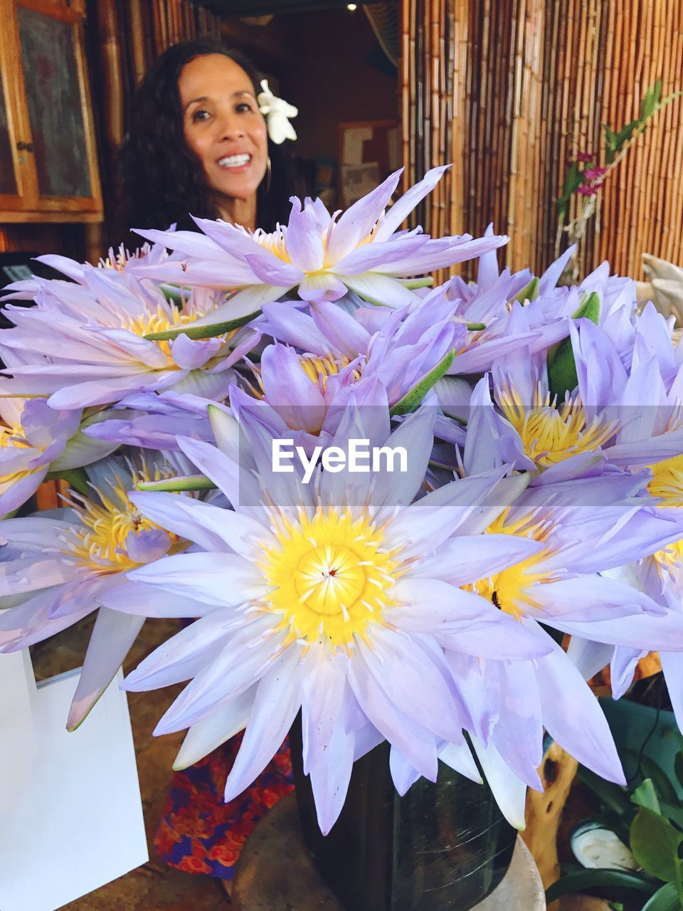 flower, purple, retail, outdoors, real people, looking at camera, smiling, beauty in nature, one person, freshness, happiness, day, nature, fragility, florist, flower head, close-up, people