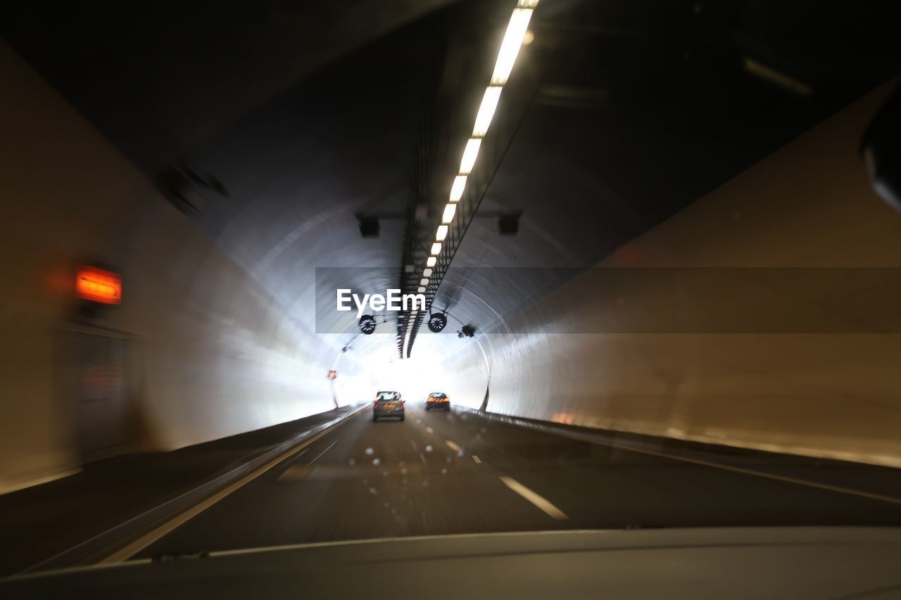 transportation, vehicle interior, illuminated, tunnel, the way forward, car, mode of transport, travel, indoors, windshield, land vehicle, underground, built structure, car interior, architecture, no people, day