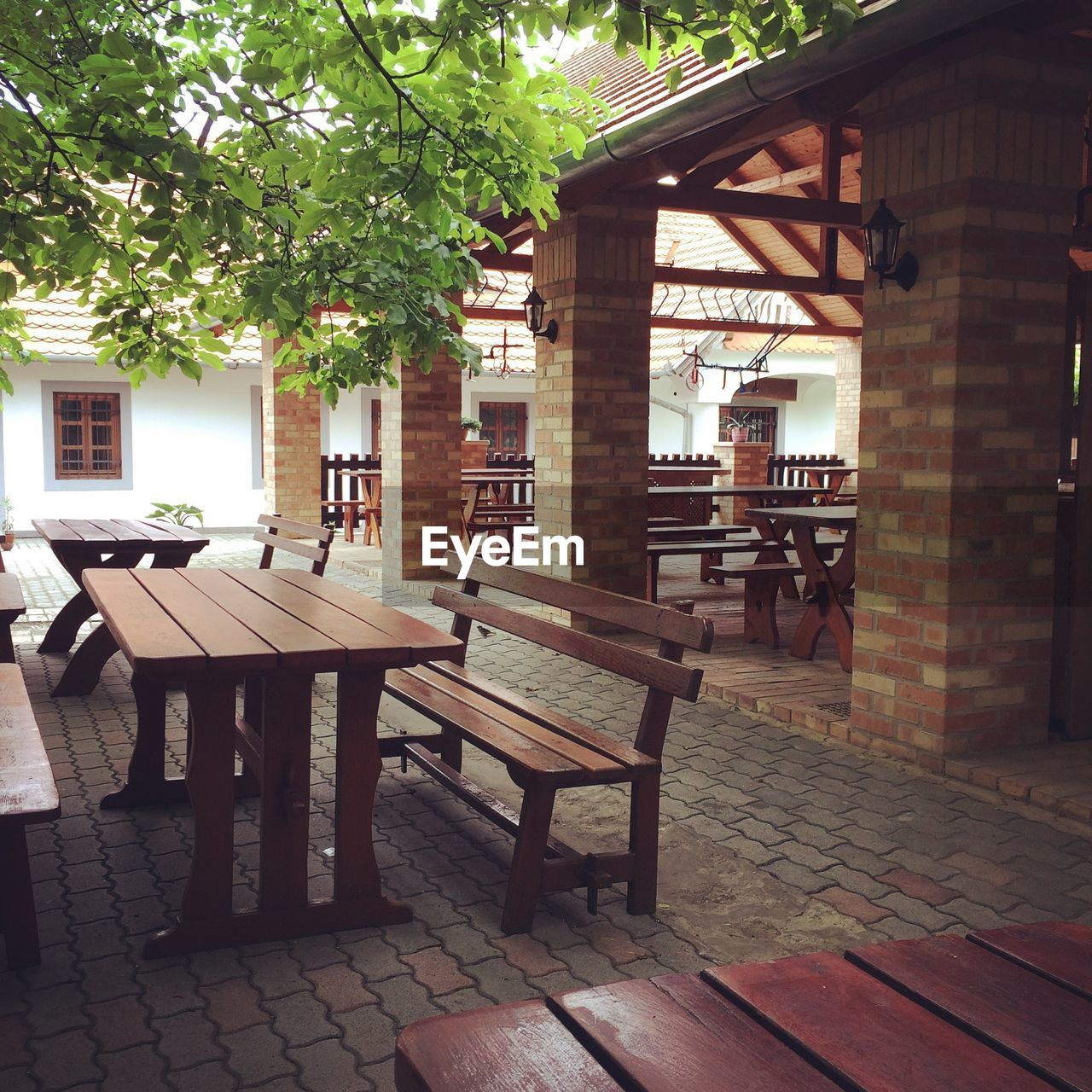 table, architecture, built structure, chair, building exterior, day, wood - material, outdoors, no people, tree