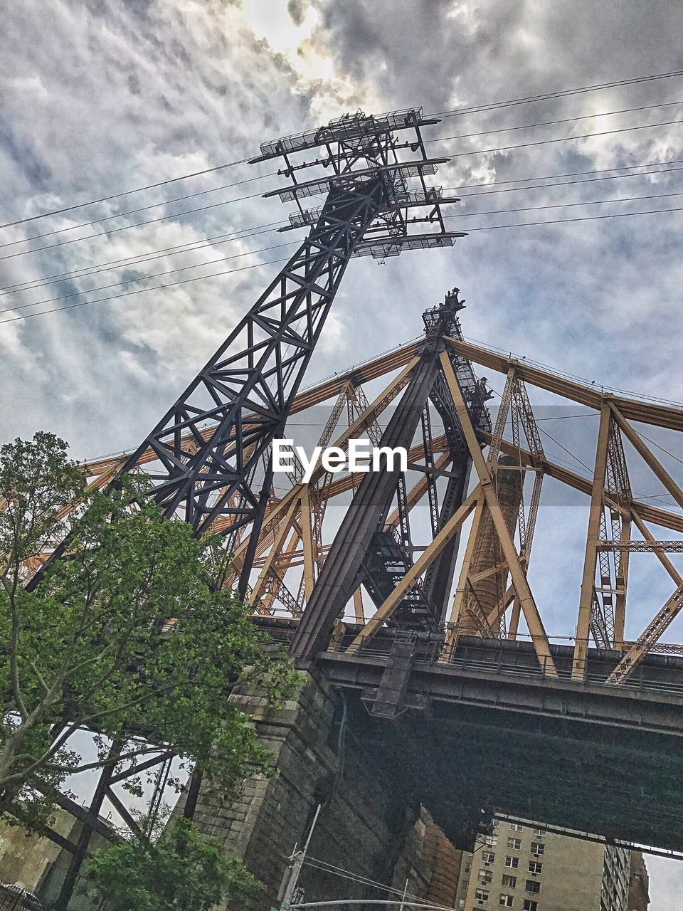 architecture, sky, built structure, cloud - sky, nature, no people, connection, low angle view, day, plant, metal, outdoors, tree, industry, bridge, transportation, fuel and power generation, bridge - man made structure, cable
