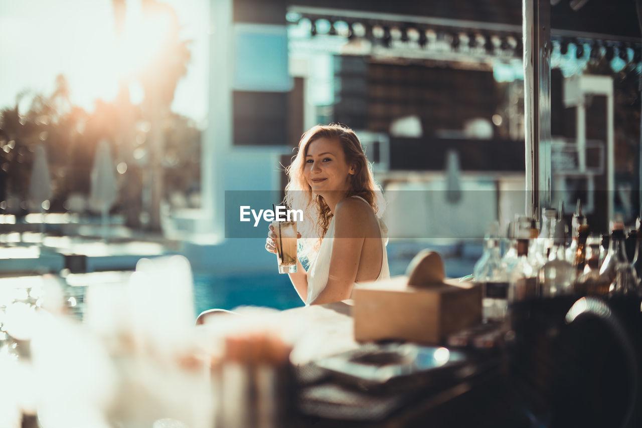 Woman sitting and looking at camera