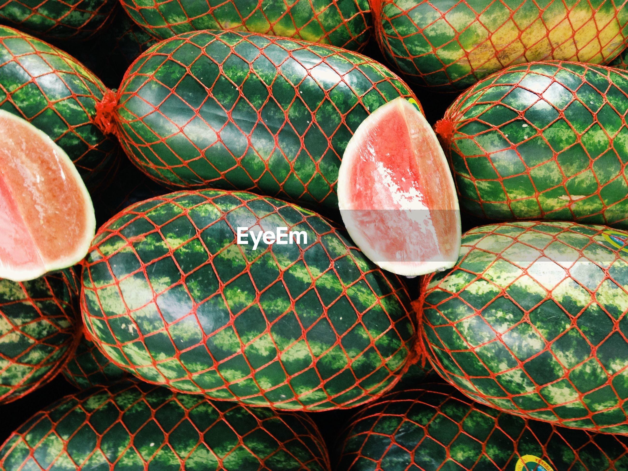 Watermelons in net