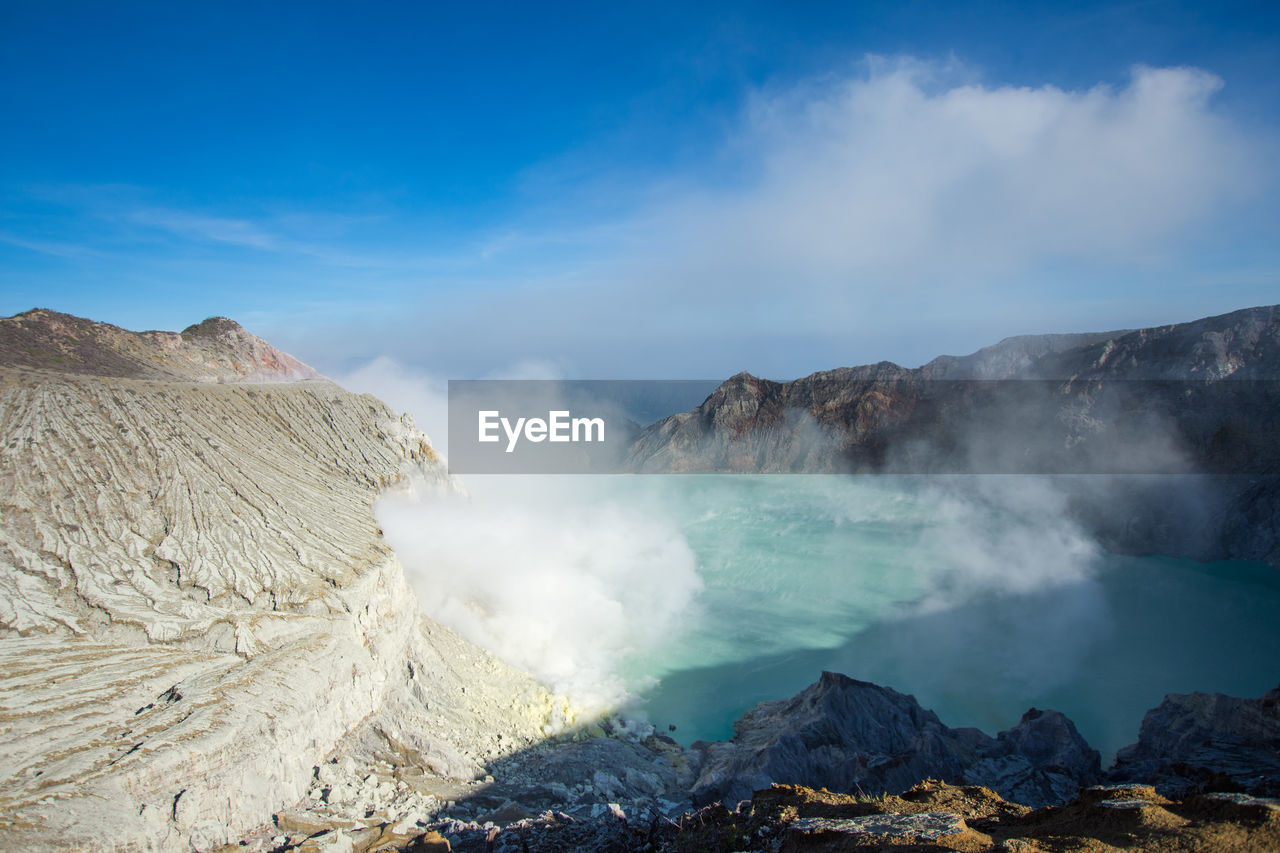 geology, beauty in nature, mountain, physical geography, scenics - nature, smoke - physical structure, volcano, non-urban scene, power in nature, steam, heat - temperature, erupting, nature, landscape, environment, tranquil scene, day, emitting, sky, hot spring, no people, volcanic crater, outdoors