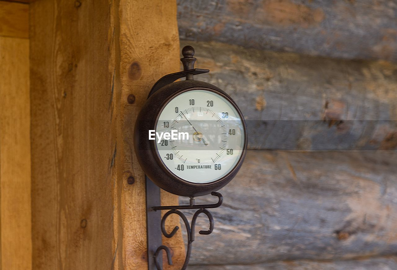 Close-up of temperature gauge on wall