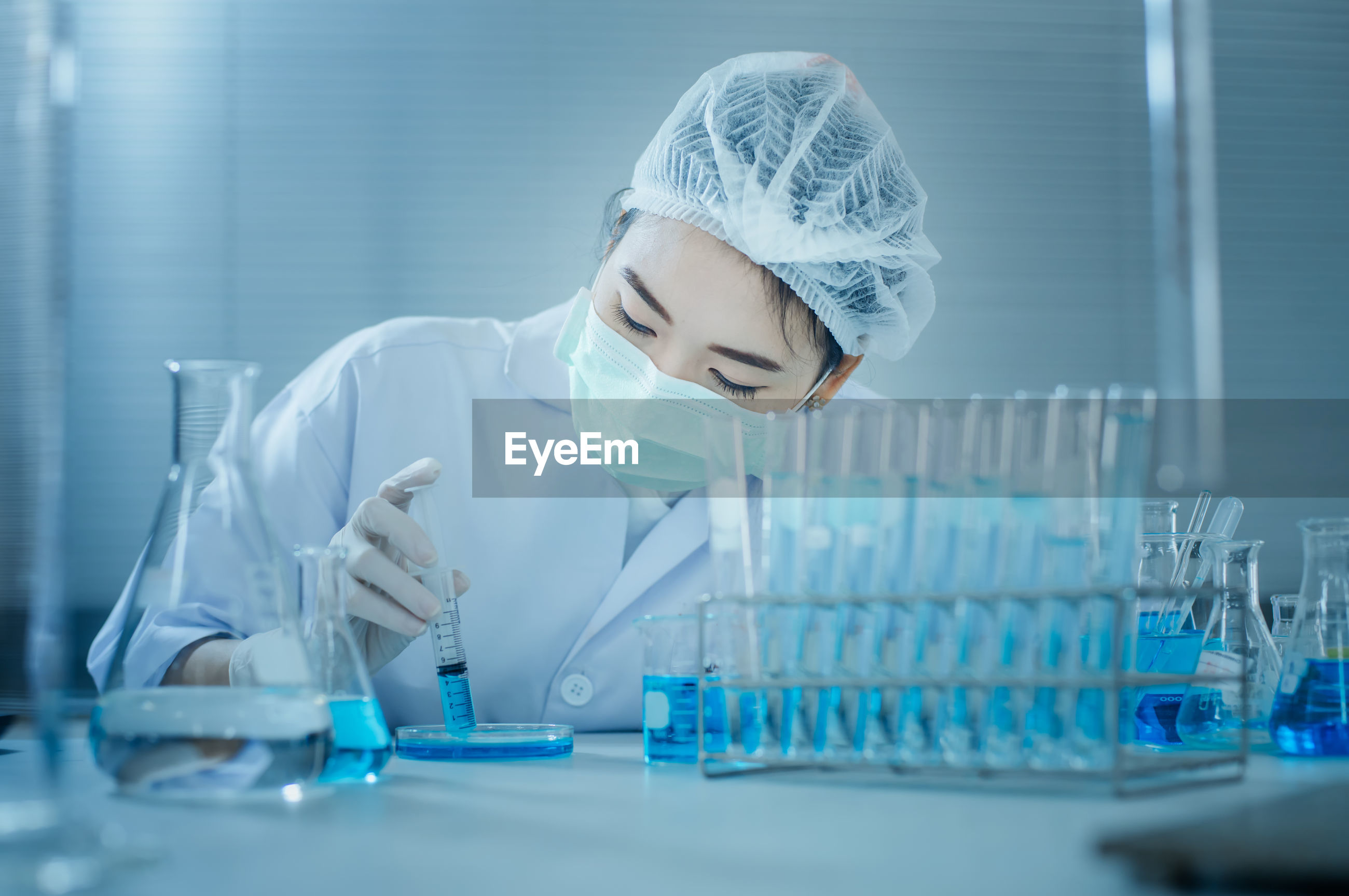 Scientist doing scientific experiment in laboratory