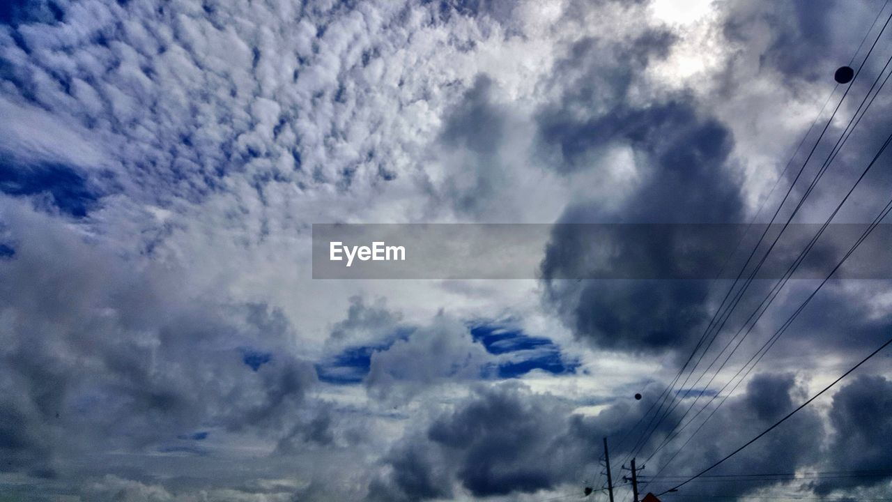 cloud - sky, sky, low angle view, cable, electricity, power line, no people, nature, day, electricity pylon, beauty in nature, connection, power supply, technology, outdoors, overcast, fuel and power generation, scenics - nature, tranquil scene, telephone line