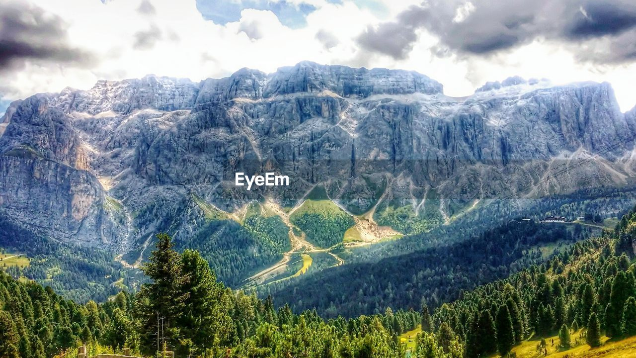 mountain, mountain range, nature, scenics, beauty in nature, landscape, no people, green color, tree, outdoors, tranquil scene, tranquility, day, physical geography, rural scene, sky, range